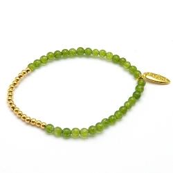 Armband 4mm steenkralen lichtgroen met verguld gouden balletjes