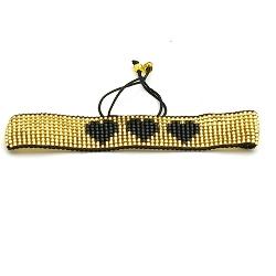 Armband plat geweven mijuki kraaltjes goud met zwarte hartjes