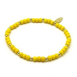 Armband dyed turquoise 4mm geel met 14krt balletjes