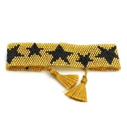 Armband plat geweven mijuki kraaltjes goud met zwarte sterren