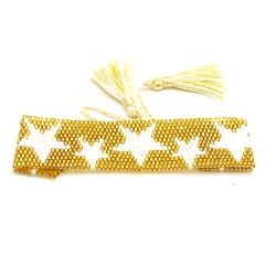 Armband plat geweven mijuki kraaltjes goud met witte sterren